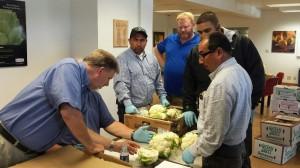 Dave Horner of USDA training Ocean Mist Farms QA and Harvesting team employees