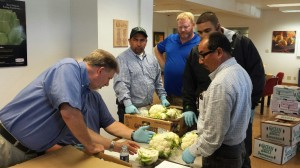 Dave Horner of USDA training Ocean Mist Farms QA and Harvesting team employees