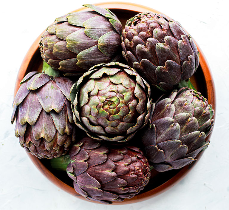 bowl of purple artichokes