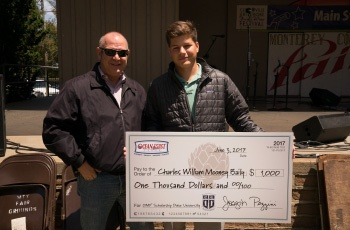 Charles Bailey receiving a scholarship check