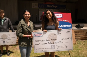 Krista Arellano receiving a scholarship check