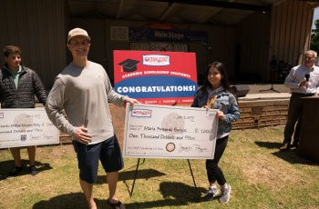 Maria Barajas receiving a scholarship check