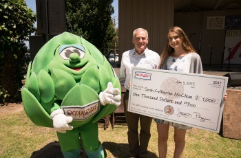 Sarah McClean receiving a scholarship check